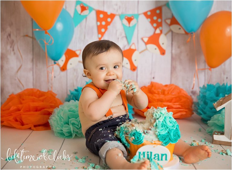 Little boy eating his cake photo by Lifetime of Clicks Photography