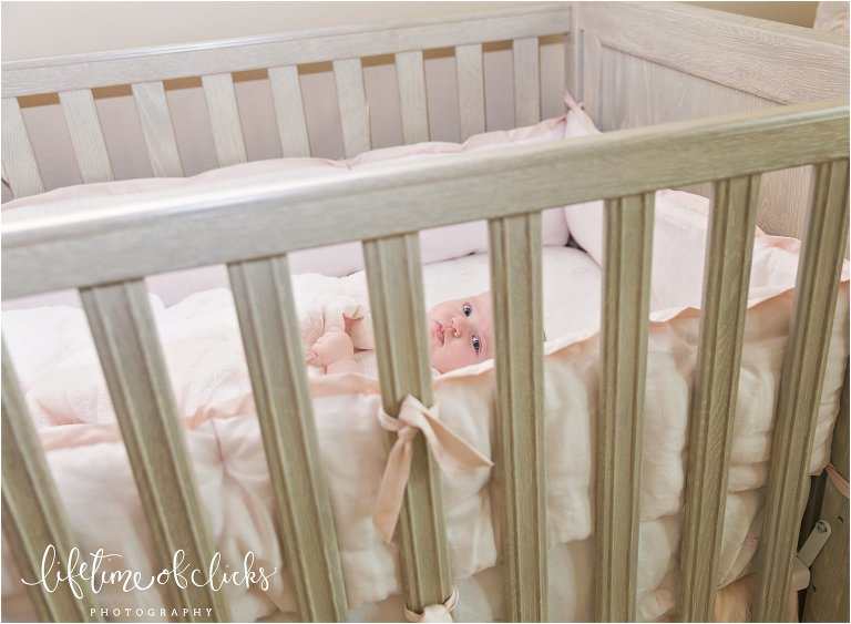 Newborn in crib photo | Fulshear TX Family Photographer