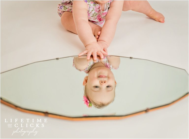 One year old portraits with mirror