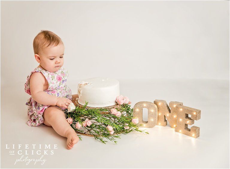 one year old portrait with organic cake