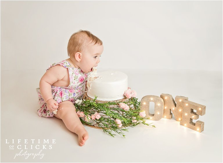 little girl eating her birthday cake