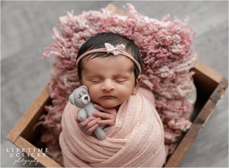 newborn girl wearing pink headband