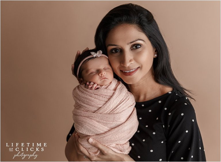 mommy-daughter photo during newborn session