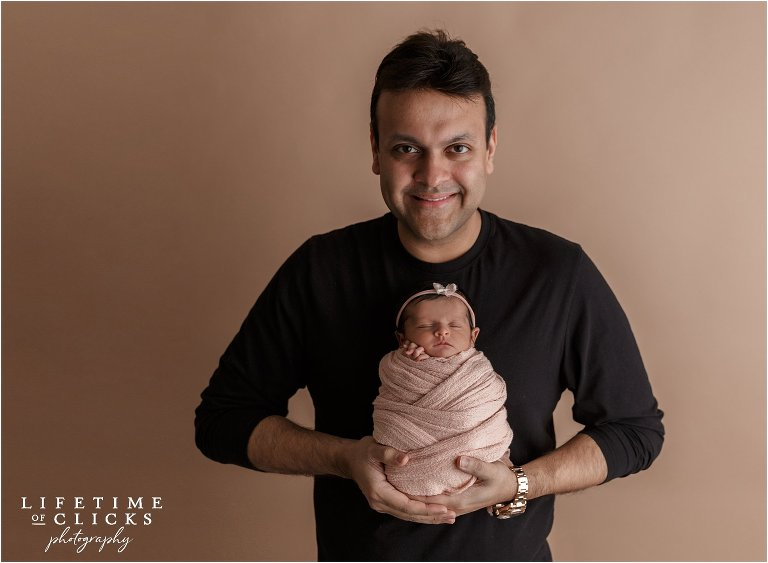newborn girl with her proud father