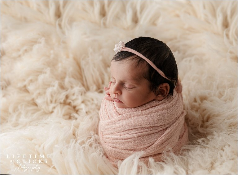 newborn girl on flokati fur
